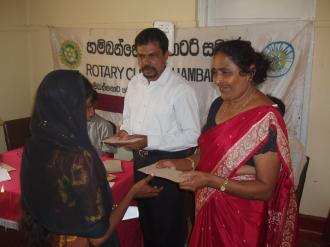 Photo: Prem presenting donations in Hambantota