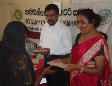 Photo: Prem presenting relief aid